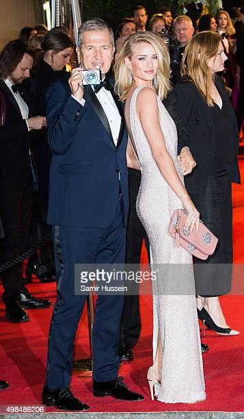Rosie Huntington Whiteley and Mario Testino attend the British Fashion Awards 2015 at London Coliseum on November 23 2015 in London England