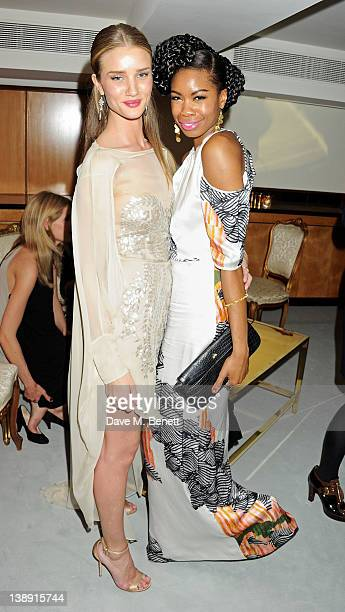 Rosie Huntington Whiteley and Tolula Adeyemi attend an after party following the ELLE Style Awards at The Savoy Hotel on February 13 2012 in London...