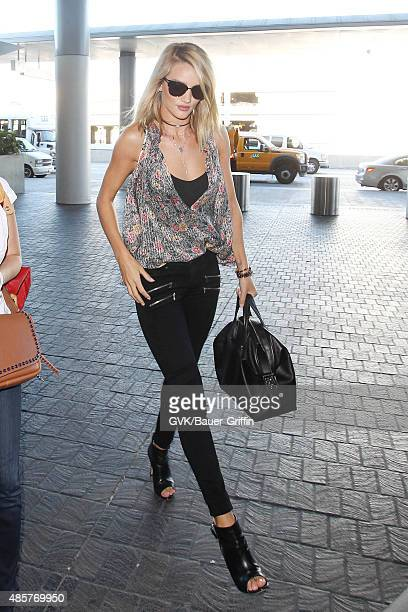 Rosie Huntington Whiteley is seen at LAX on August 29 2015 in Los Angeles California