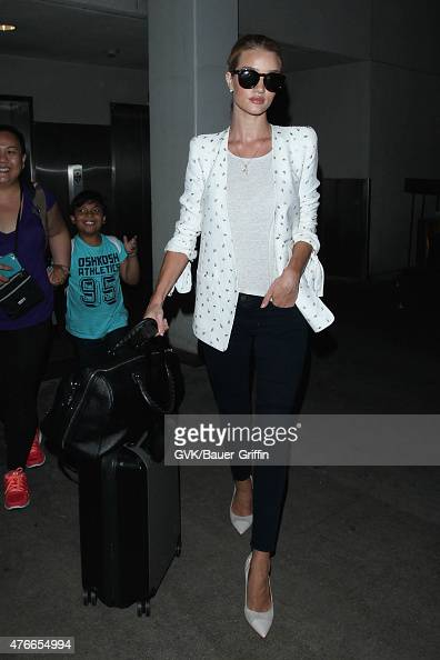 Rosie Huntington Whiteley is seen at LAX on June 10 2015 in Los Angeles California