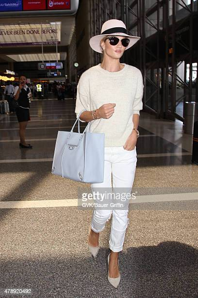 Rosie Huntington Whiteley is seen at LAX on June 28 2015 in Los Angeles California