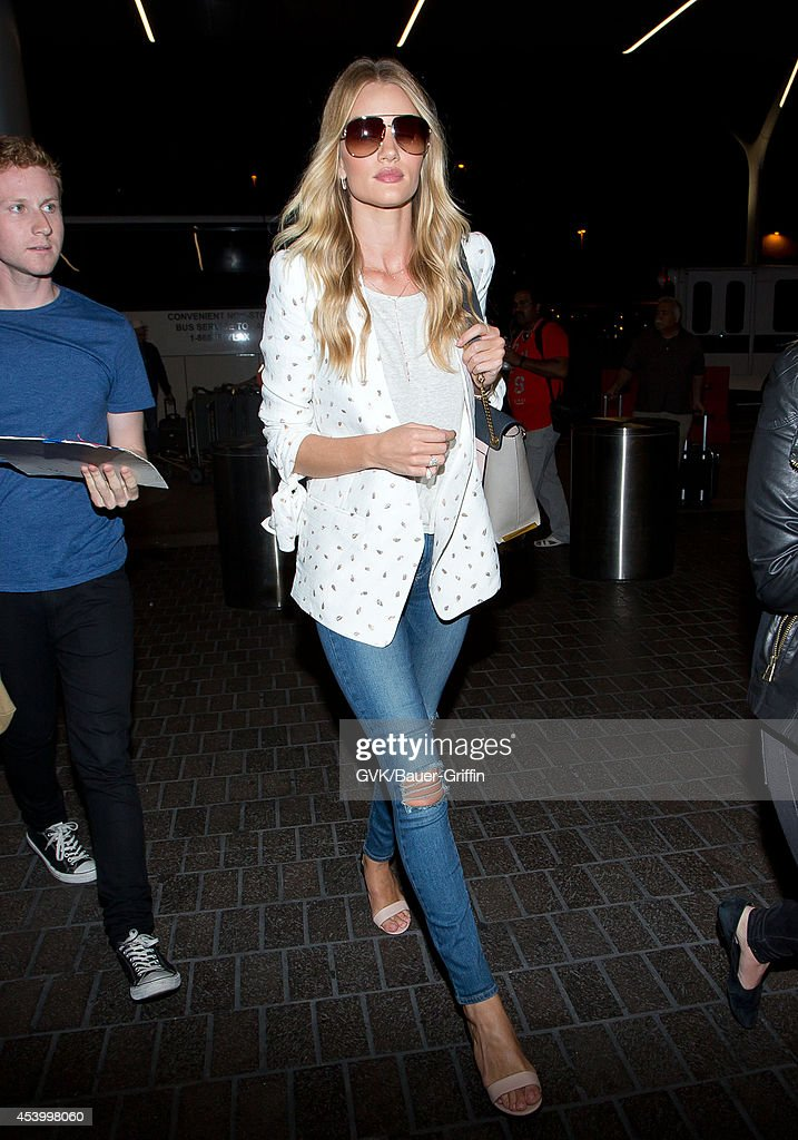 Rosie Huntington Whiteley seen at LAX on August 22, 2014 in Los Angeles, California.