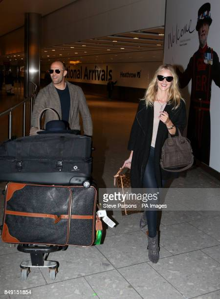 Rosie HuntingtonWhiteley and boyfriend Jason Statham arrive at Terminal 5 of Heathrow Airport PRESS ASSOCIATION Photo Picture date Tuesday December...