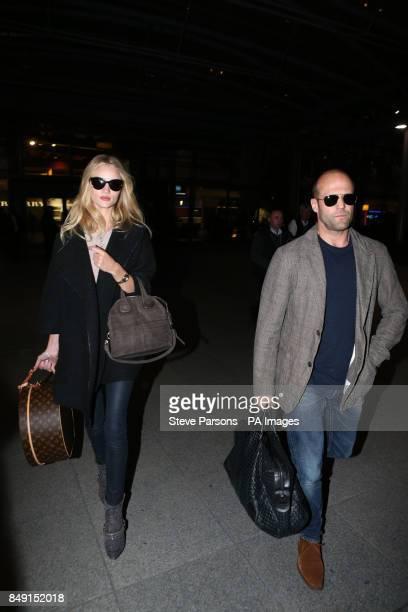 Rosie HuntingtonWhiteley and boyfriend Jason Statham arrive at Terminal 5 of Heathrow Airport