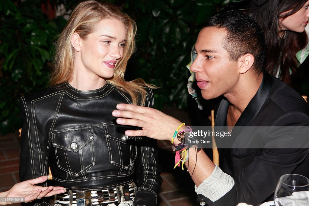 Rosie Huntington-Whiteley and Designer Olivier Rousteing attend the Balmain LA Dinner at Chateau Marmont on May 2, 2013 in Los Angeles, California.