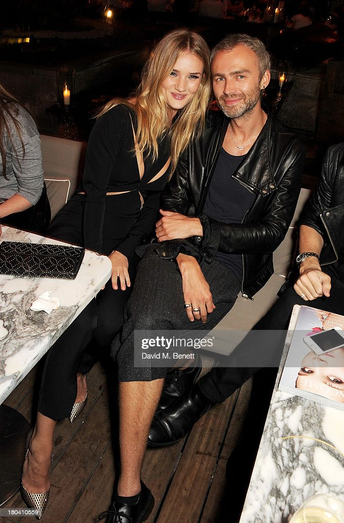 Rosie Huntington-Whiteley (L) and guest attend the ELLE Magazine drinks reception celebrating London Fashion Week SS14 at the Sanderson Hotel on September 12, 2013 in London, England.