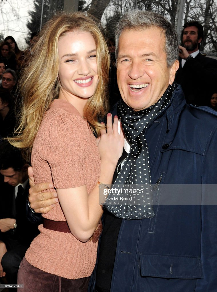 Rosie Huntington-Whiteley (L) and Mario Testino attend the Burberry Autumn Winter 2012 Womenswear Front Row during London Fashion Week at Kensington Gardens on February 20, 2012 in London, England.