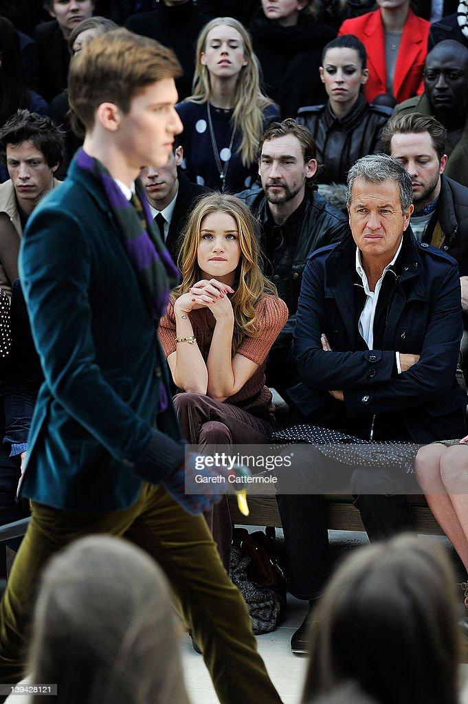 Rosie Huntington-Whiteley and Mario Testino attend the Burberry Autumn Winter 2012 Womenswear Front Row during London Fashion Week at Kensington Gardens on February 20, 2012 in London, England.