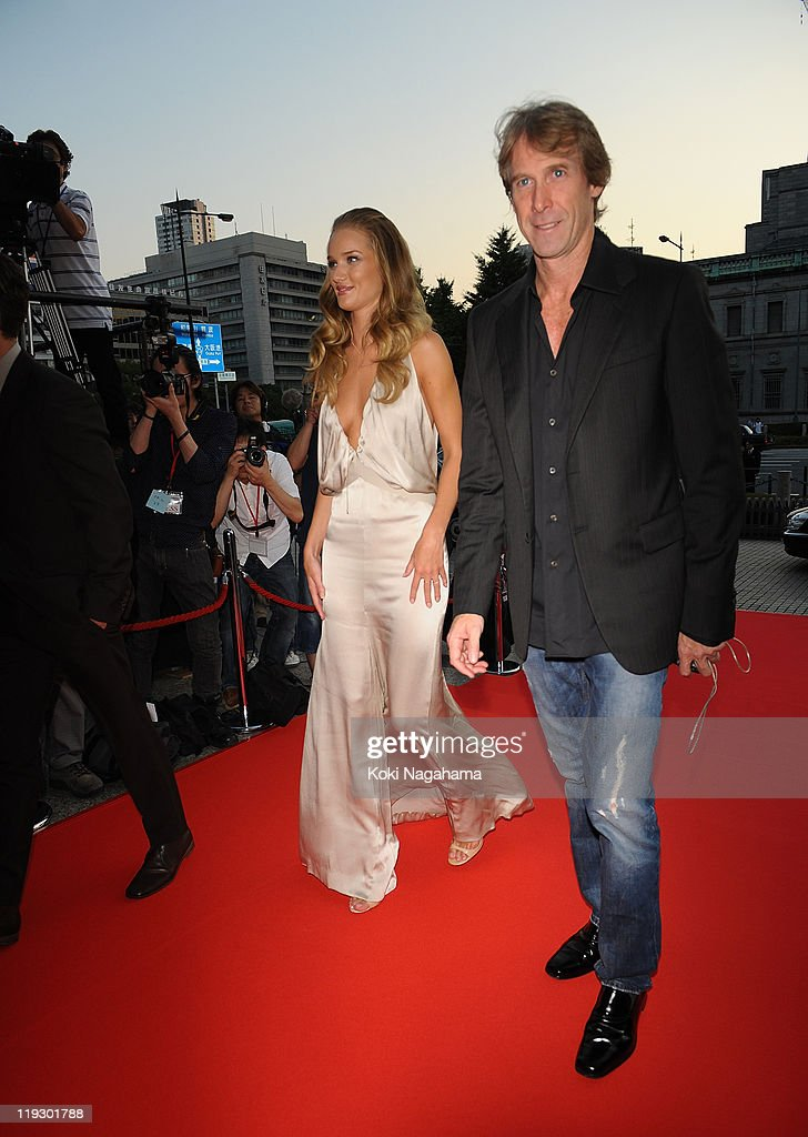 <a gi-track='captionPersonalityLinkClicked' href=/galleries/search?phrase=Rosie+Huntington-Whiteley&family=editorial&specificpeople=2244343 ng-click='$event.stopPropagation()'>Rosie Huntington-Whiteley</a> and <a gi-track='captionPersonalityLinkClicked' href=/galleries/search?phrase=Michael+Bay&family=editorial&specificpeople=240532 ng-click='$event.stopPropagation()'>Michael Bay</a> during the 'Transformers: Dark of the Moon' stage greeting at Osaka Station City Cinema on July 16, 2011 in Osaka, Japan. The film will open on July 29 in Japan.