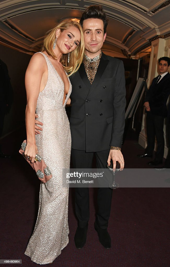 Rosie Huntington-Whiteley (L) and Nick Grimshaw attend a drinks reception at the British Fashion Awards in partnership with Swarovski at the London Coliseum on November 23, 2015 in London, England.