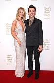 Rosie HuntingtonWhiteley and Nick Grimshaw pose in the Winners Room at the British Fashion Awards 2015 at London Coliseum on November 23 2015 in...