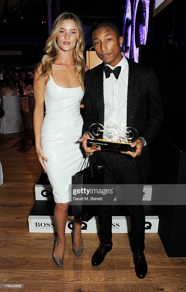 Rosie Huntington-Whiteley (L) and Pharrell Williams, winner of Best Performer, attend the GQ Men of the Year awards at The Royal Opera House on September 3, 2013 in London, England.