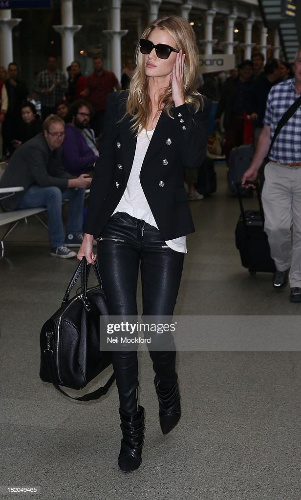 <a gi-track='captionPersonalityLinkClicked' href=/galleries/search?phrase=Rosie+Huntington-Whiteley&family=editorial&specificpeople=2244343 ng-click='$event.stopPropagation()'>Rosie Huntington-Whiteley</a> arriving at Eurostar in London on September 27, 2013.