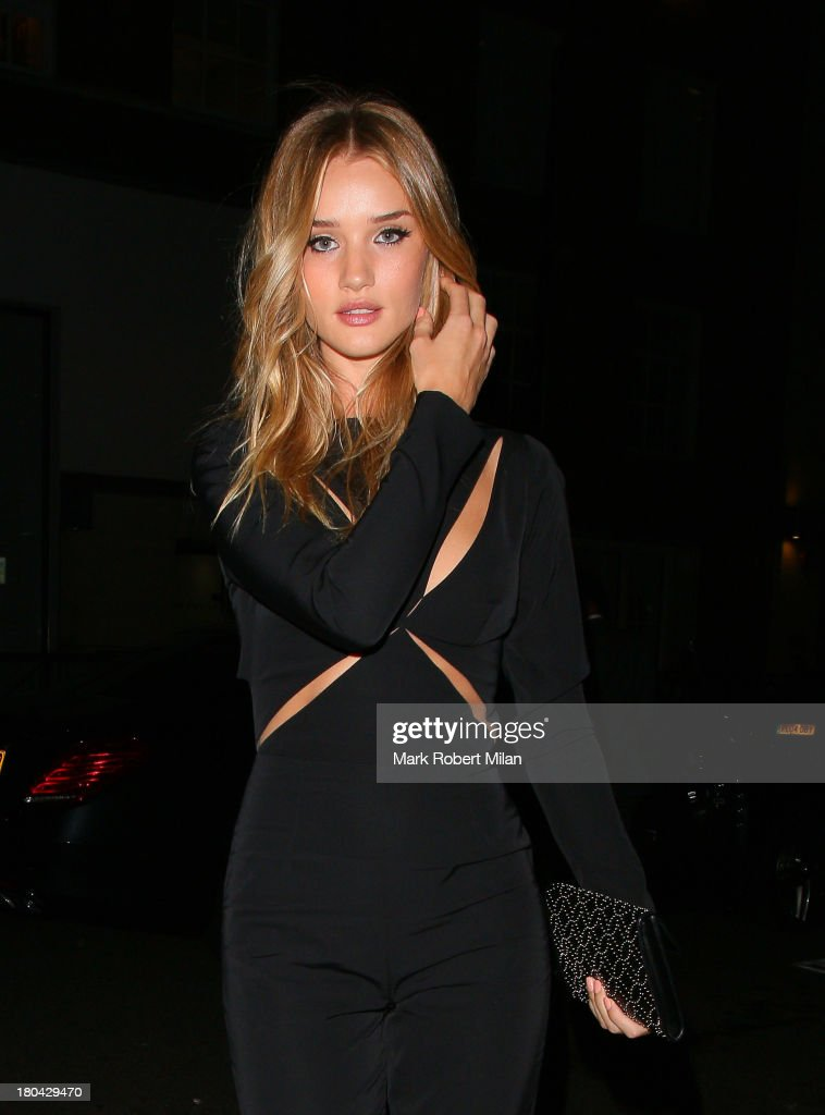 <a gi-track='captionPersonalityLinkClicked' href=/galleries/search?phrase=Rosie+Huntington-Whiteley&family=editorial&specificpeople=2244343 ng-click='$event.stopPropagation()'>Rosie Huntington-Whiteley</a> arriving at the ELLE magazine October issue party at the Sanderson hotel on September 12, 2013 in London, England.