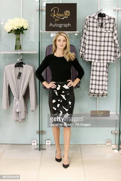 Rosie HuntingtonWhiteley attends a photocall to launch her 'Rosie for Autograph Sleepwear' collection at MS Marble Arch Oxford Street London