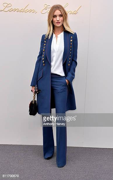 Rosie HuntingtonWhiteley attends the Burberry show during London Fashion Week Autumn/Winter 2016/17 at Kensington Gardens on February 22 2016 in...