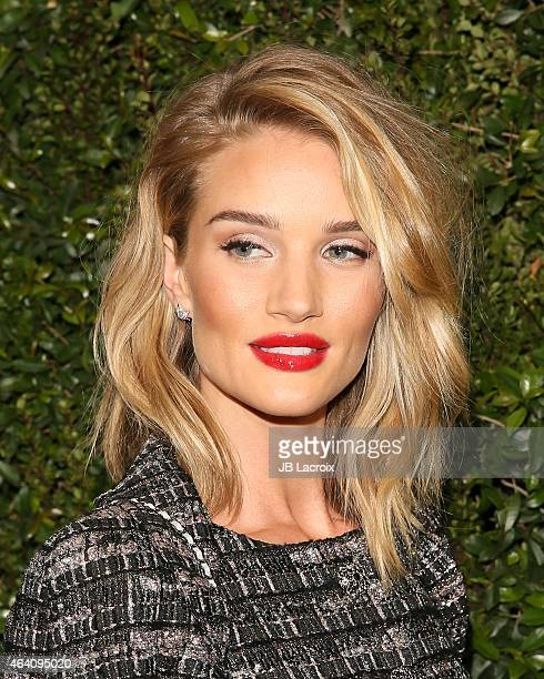 Rosie HuntingtonWhiteley attends the Chanel And Charles Finch PreOscar Dinner at Madeo Restaurant on February 21 2015 in West Hollywood California