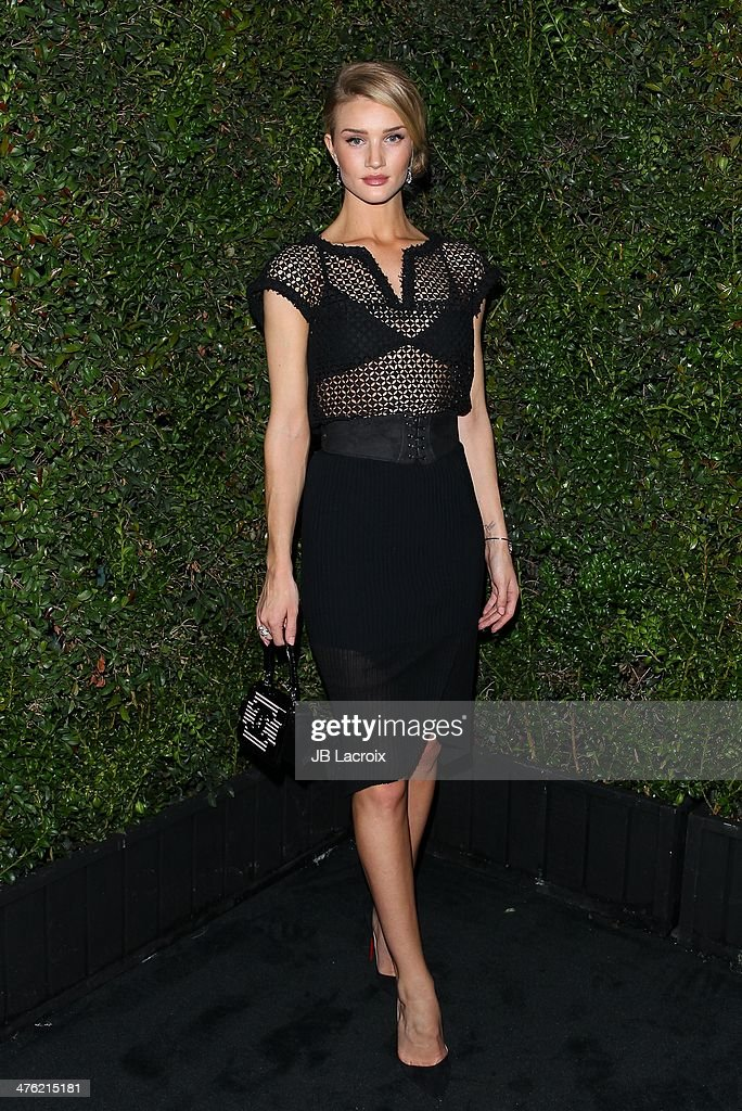 Rosie Huntington-Whiteley attends the Chanel Charles Finch Pre-Oscar Dinner held at Madeo Restaurant on March 1, 2014 in Los Angeles, California.