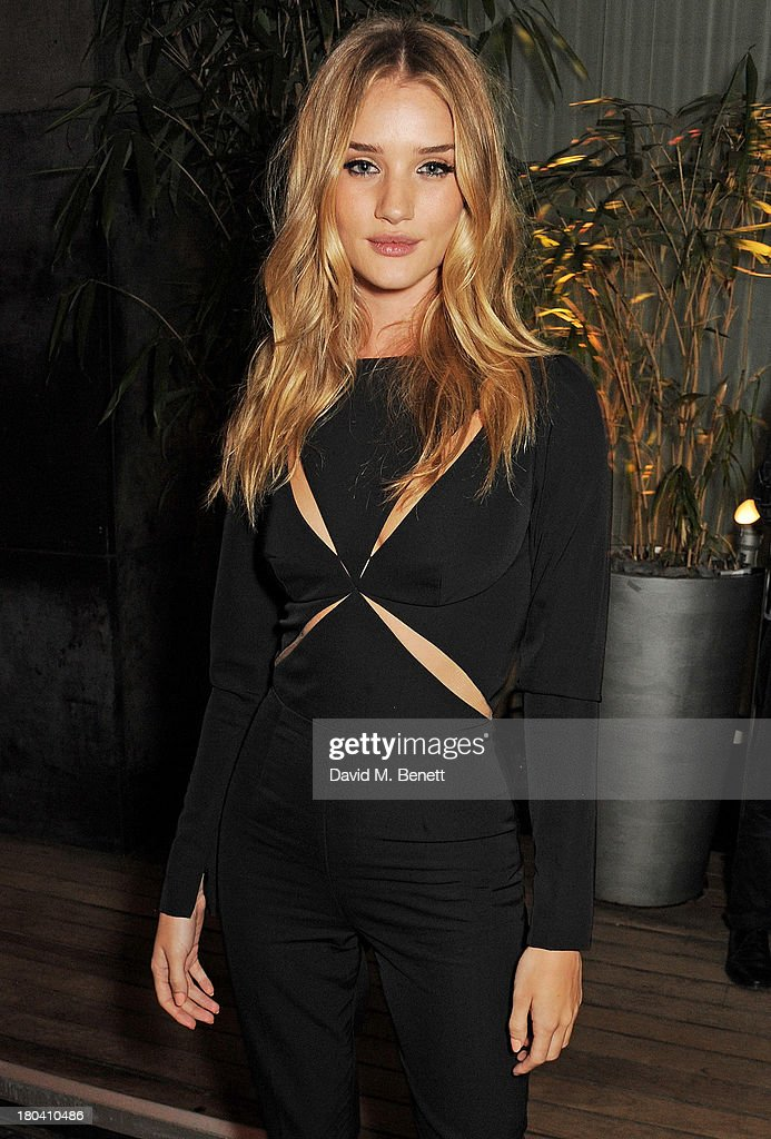 <a gi-track='captionPersonalityLinkClicked' href=/galleries/search?phrase=Rosie+Huntington-Whiteley&family=editorial&specificpeople=2244343 ng-click='$event.stopPropagation()'>Rosie Huntington-Whiteley</a> attends the ELLE Magazine drinks reception celebrating London Fashion Week SS14 at the Sanderson Hotel on September 12, 2013 in London, England.
