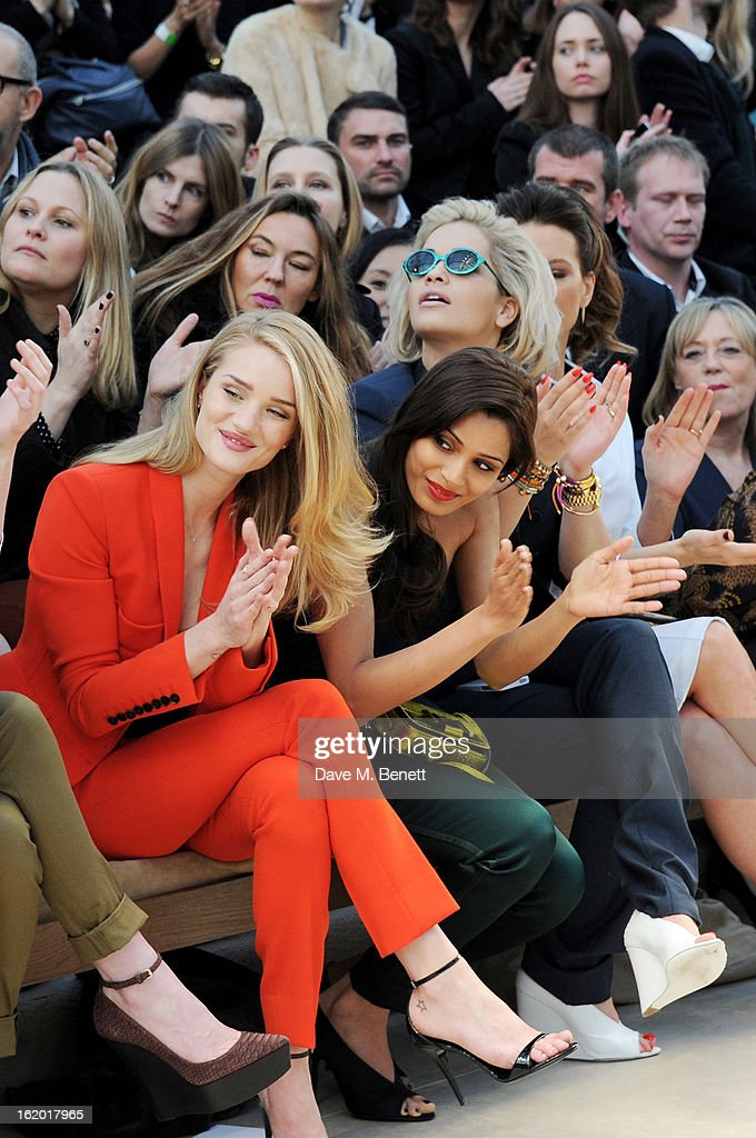 Rosie Huntington-Whiteley, Freida Pinto and Rita Ora sit in the front row for the Burberry Prorsum Autumn Winter 2013 Womenswear Show at Kensington Gardens on February 18, 2013 in London, England.