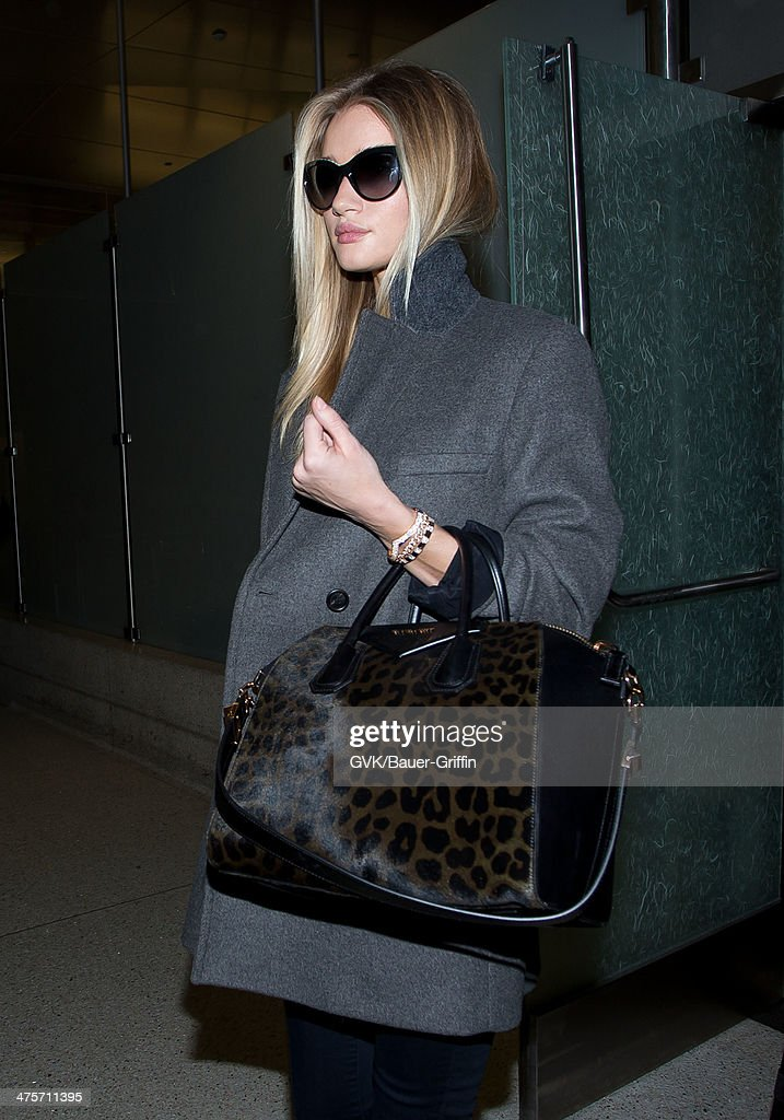 <a gi-track='captionPersonalityLinkClicked' href=/galleries/search?phrase=Rosie+Huntington-Whiteley&family=editorial&specificpeople=2244343 ng-click='$event.stopPropagation()'>Rosie Huntington-Whiteley</a> is seen at LAX on February 28, 2014 in Los Angeles, California.