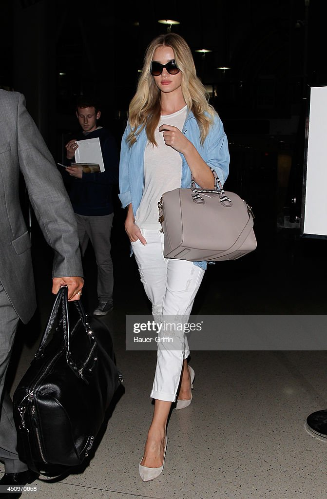 <a gi-track='captionPersonalityLinkClicked' href=/galleries/search?phrase=Rosie+Huntington-Whiteley&family=editorial&specificpeople=2244343 ng-click='$event.stopPropagation()'>Rosie Huntington-Whiteley</a> is seen at LAX on June 20, 2014 in Los Angeles, California.