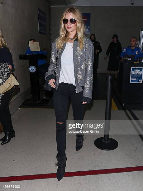 Rosie HuntingtonWhiteley is seen at Los Angeles International Airport on October 21 2015 in Los Angeles California