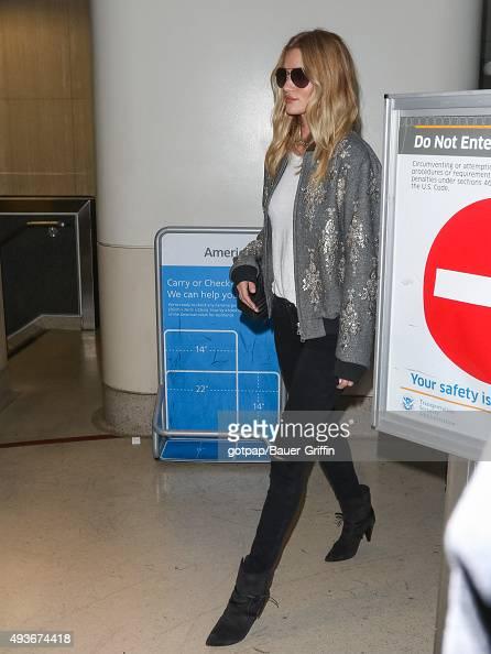 Rosie HuntingtonWhiteley is seen at Los Angeles International Airport on October 21 2015 in Los Angeles California
