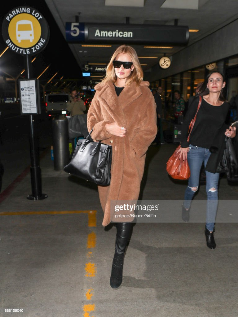 Rosie Huntington-Whiteley is seen at Los Angeles International Airport on December 07, 2017 in Los Angeles, California.