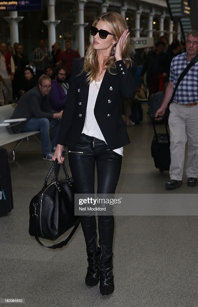 <a gi-track='captionPersonalityLinkClicked' href=/galleries/search?phrase=Rosie+Huntington-Whiteley&family=editorial&specificpeople=2244343 ng-click='$event.stopPropagation()'>Rosie Huntington-Whiteley</a> seen arriving at Eurostar King's Cross St Pancras on September 27, 2013 in London, England.