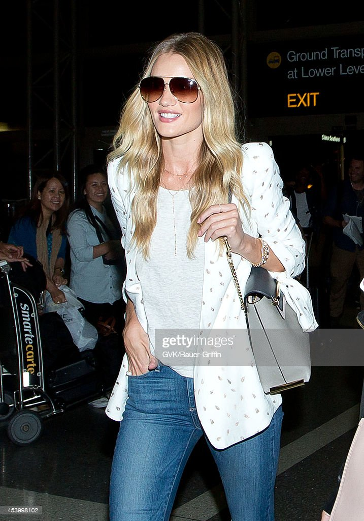 Rosie Huntington-Whiteley seen at LAX on August 22, 2014 in Los Angeles, California.