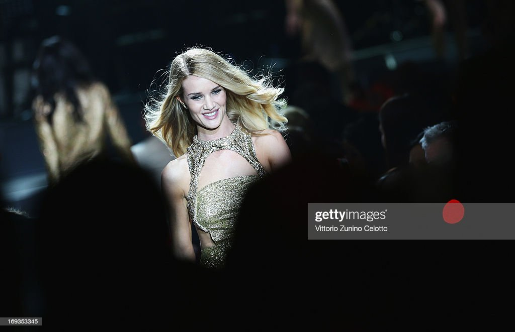 <a gi-track='captionPersonalityLinkClicked' href=/galleries/search?phrase=Rosie+Huntington-Whiteley&family=editorial&specificpeople=2244343 ng-click='$event.stopPropagation()'>Rosie Huntington-Whiteley</a> walks the runway at amfAR's 20th Annual Cinema Against AIDS during The 66th Annual Cannes Film Festival at Hotel du Cap-Eden-Roc on May 23, 2013 in Cap d'Antibes, France.