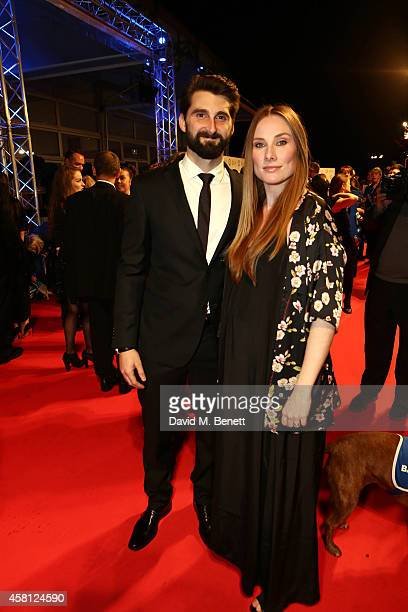 Rosie Marcel and Ben Stacey attend Battersea Dogs Cats Home's 'Collars Coats Gala Ball' at Battersea Evolution on October 30 2014 in London England
