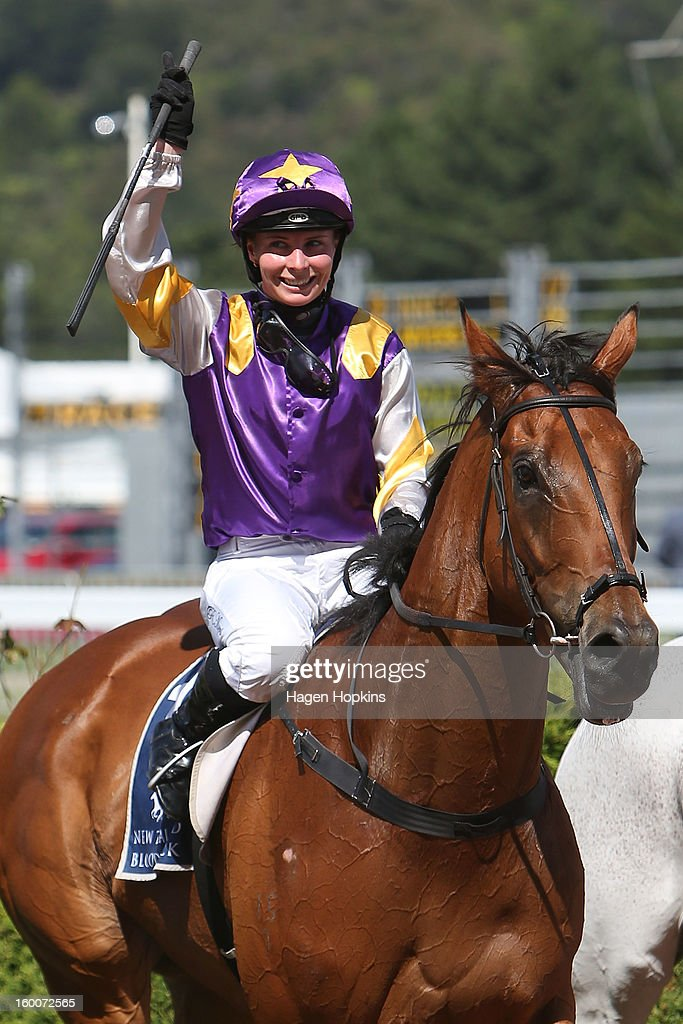 Rosie Myers riding Historian salutes the crowd after winning the 1600m Group I Harcourts Thorndon Mile during Wellington Cup Day at Trentham Racecourse on January 26, 2013 in Wellington, New Zealand.
