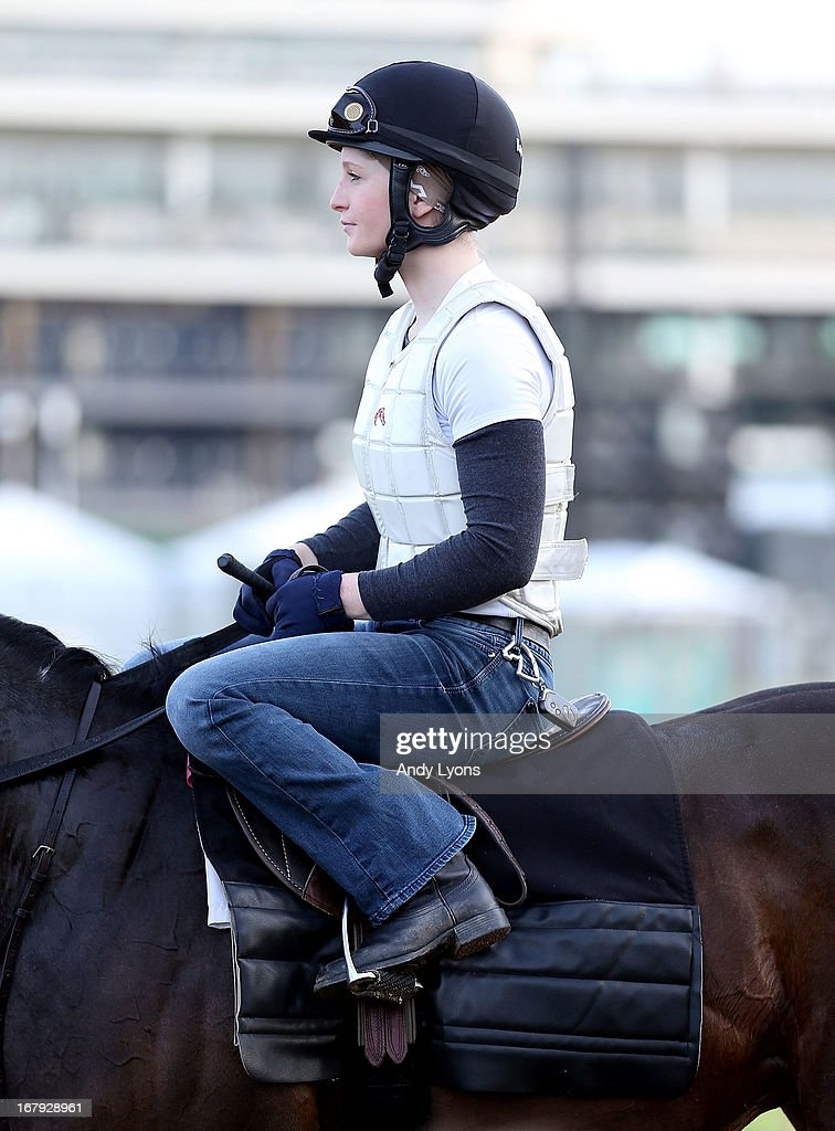 <a gi-track='captionPersonalityLinkClicked' href=/galleries/search?phrase=Rosie+Napravnik&family=editorial&specificpeople=7735511 ng-click='$event.stopPropagation()'>Rosie Napravnik</a> the jockey for Mylute sits on a horse during the morning training for the 2013 Kentucky Derby at Churchill Downs on May 2, 2013 in Louisville, Kentucky.