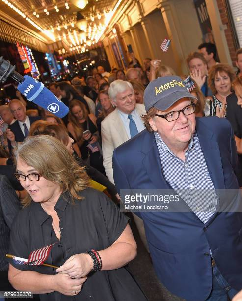 Rosie O'Donnell and awardwinning filmmaker Michael Moore celebrate his Broadway Opening Night in 'The Terms of My Surrender' at Belasco Theatre with...