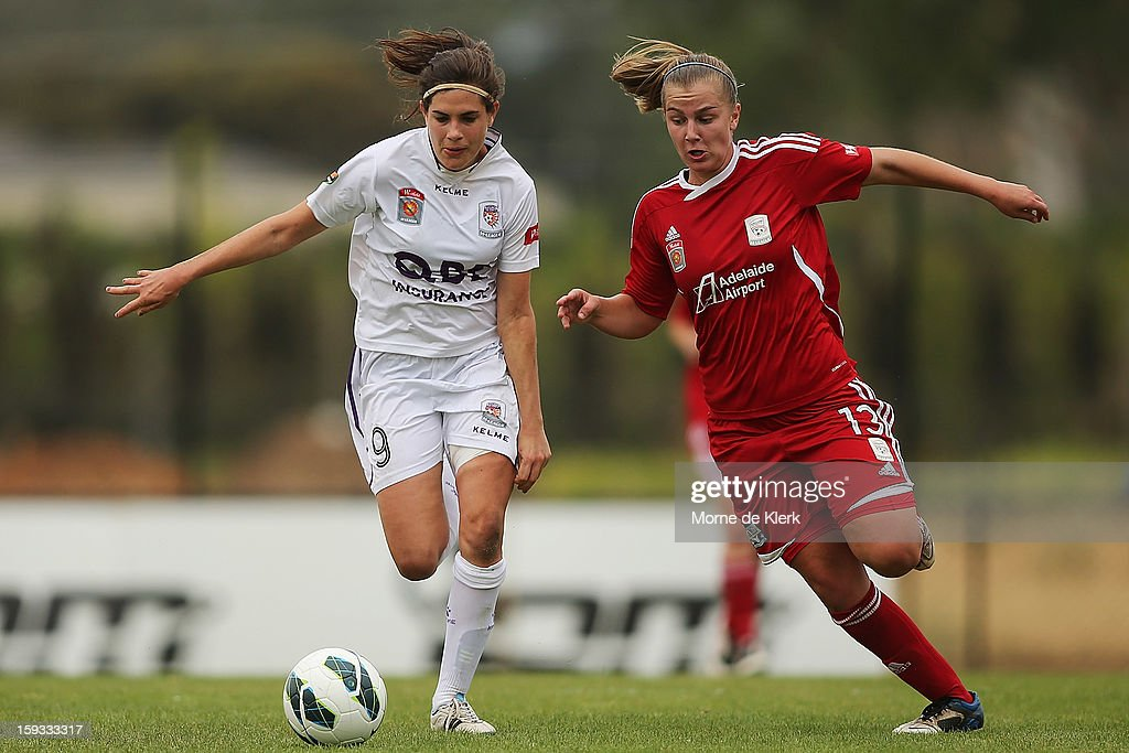 Rosie Sutton of Perth competes with Ann Mayo of Adelaide during the round 12 W-League match between Adelaide United and the Perth Glory at Burton Park on January 12, 2013 in Adelaide, Australia.