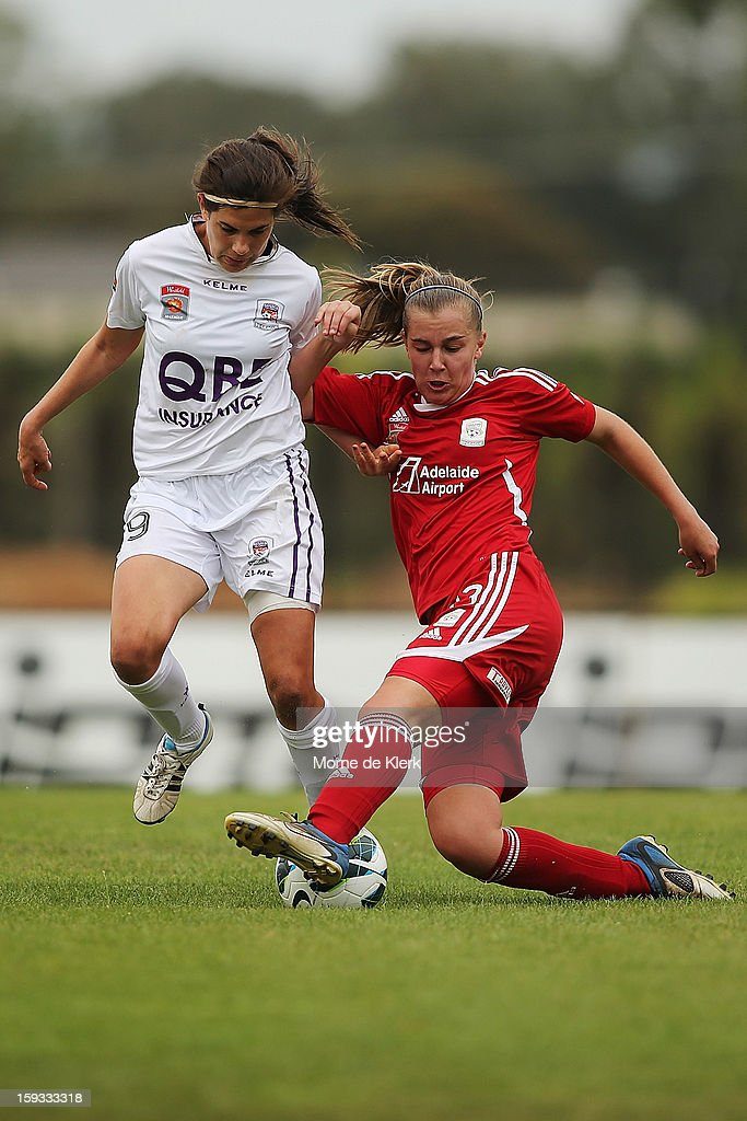 Rosie Sutton of Perth is tackled by Ann Mayo of Adelaide during the round 12 W-League match between Adelaide United and the Perth Glory at Burton Park on January 12, 2013 in Adelaide, Australia.