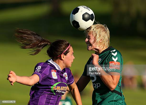 Rosie Sutton of the Glory and Catherine Brown of Canberra contest for the ball during the round six WLeague match between the Perth Glory and...