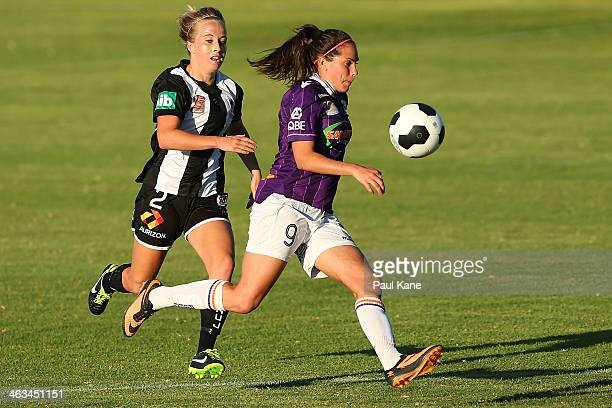 Rosie Sutton of the Glory runs onto the ball against Hannah Brewer of the Jets contest for the ball during the round nine WLeague match between the...