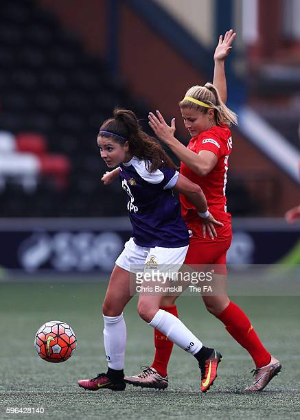 Rosie White of Liverpool Ladies FC in action with Carla Humphrey of Doncaster Rovers Belles during the FA WSL match between Liverpool Ladies FC and...