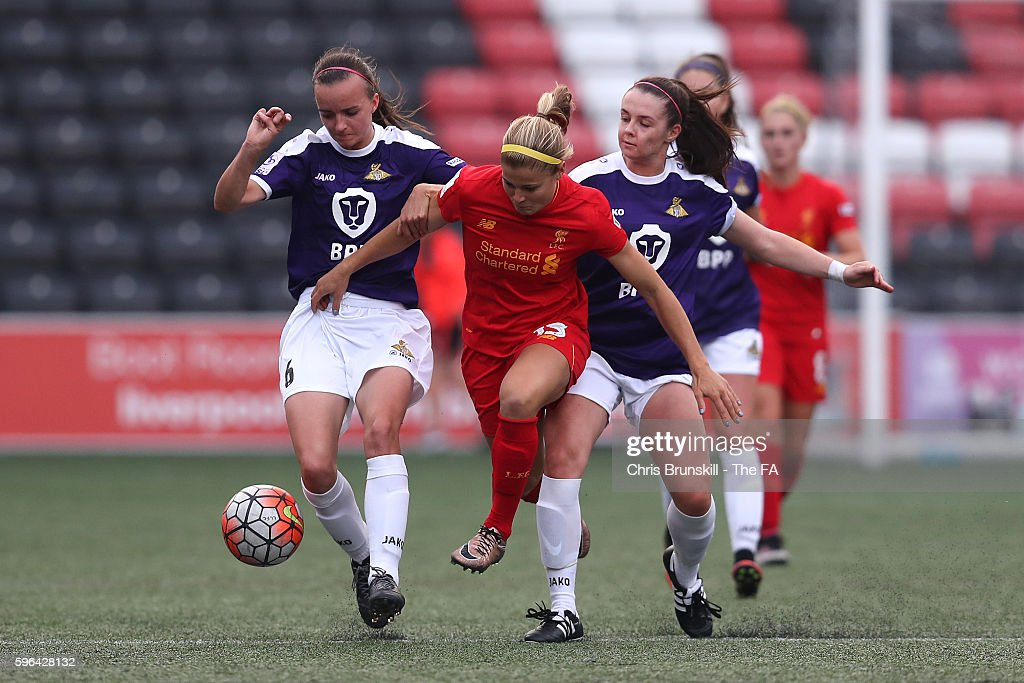 Rosie White of Liverpool Ladies FC in action with Kasia Lipka of Doncaster Rovers Belles during the FA WSL match between Liverpool Ladies FC and...