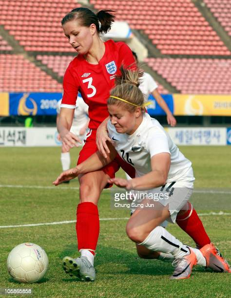 Rosie White of New Zealand and Rachel Unitt of England compete for the ball during the Peace Queen Cup match between England and New Zealand at Suwon...