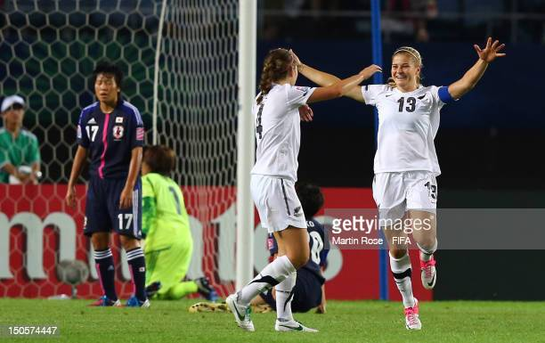 Rosie White of New Zealand celebrate with team mate Nadia Pearl after she scores her team's 2nd goal during the FIFA U20 Women's World Cup 2012 group...
