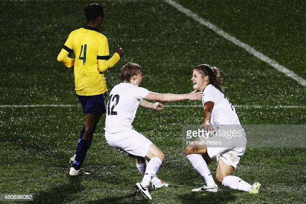 Rosie White of New Zealand celebrates with Betsy Hassett of New Zealand after scoring a goal during the Women's International friendly match between...