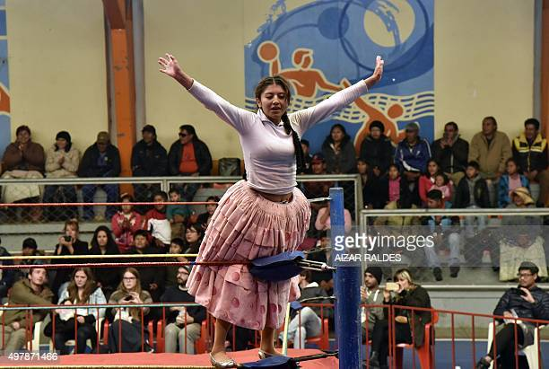 'Rosita' celebrates her victory at the end of a 'cholitas' allin wrestling fight in El Alto 12 Kms from la Paz on November 15 20152015 The fighting...