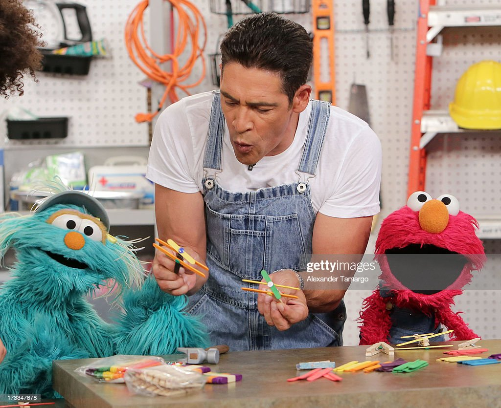 Rosita, Johnny Lozada and Elmo are seen during Sesame Street's visit of Univision's 'Despierta America' at Univision Headquarters on July 12, 2013 in Miami, Florida.