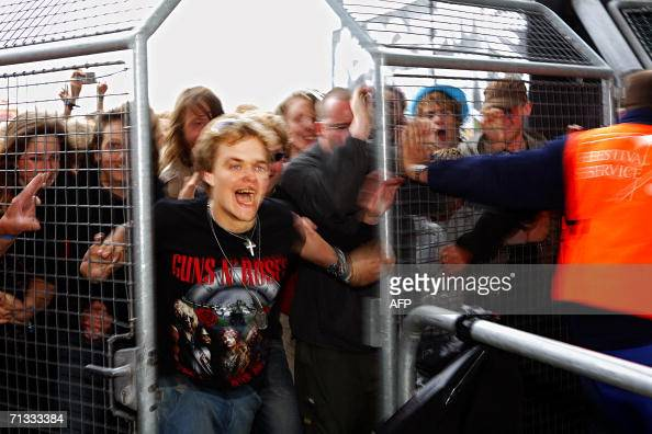 A Guns'n Roses fan rushes through the gates at the opening of the Roskilde Festival 29 June 2006 some 30 km west of Copenhagen Some 70000 rock fans...