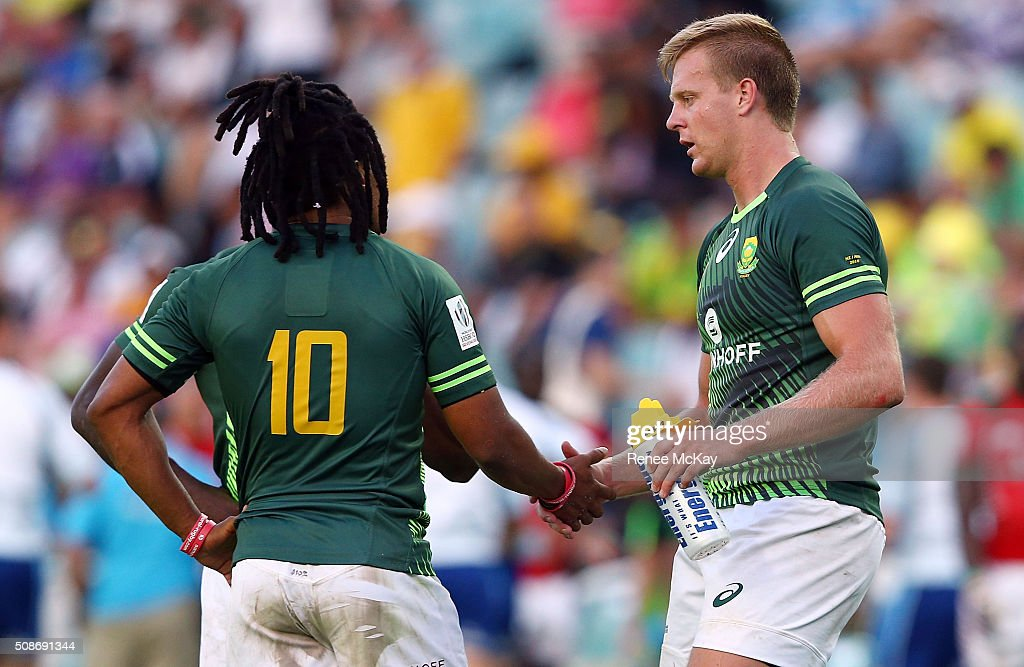 Rosko Specman and Dylan Sage of South Africa celebrate their teams win at the day 1 match between South Africa and Kenya at the HSBC Sydney Sevens at Allianz Stadium on February 06, 2016 in Sydney, Australia.