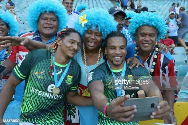 Rosko Specman of South Africa and Justin Geduld pose for a selfie with fans after the Cup Final match between England and South Africa in the 2017...